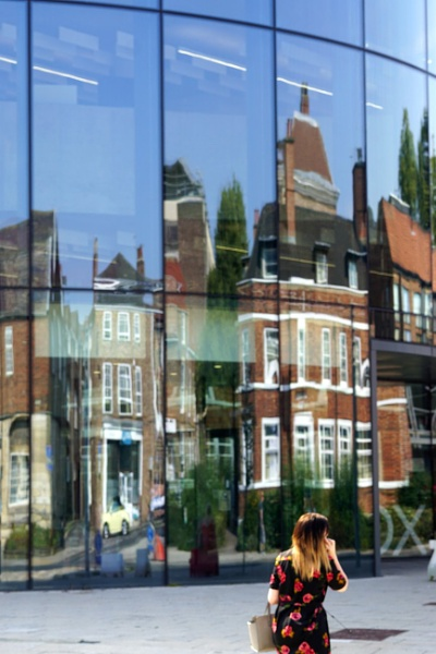 Reflections of old in the new, Hiscox building, York city centre. by MervinS