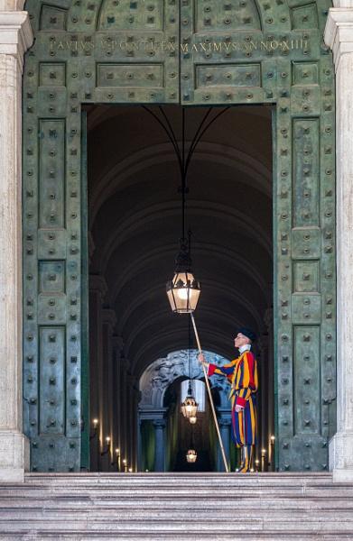 Door of Saint Peter basilica with guard by rninov