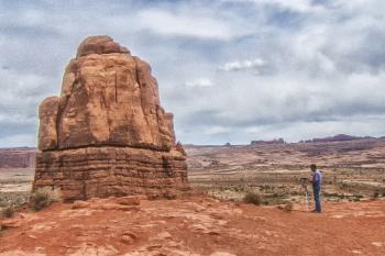 Photographer at rock formation
