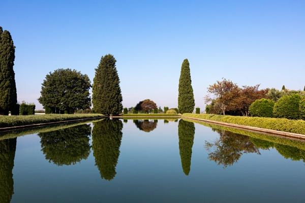 Trees and big pool in Villa Adriana park by rninov
