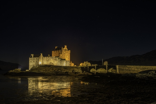 Eilean Donan castle by night by tommyegan