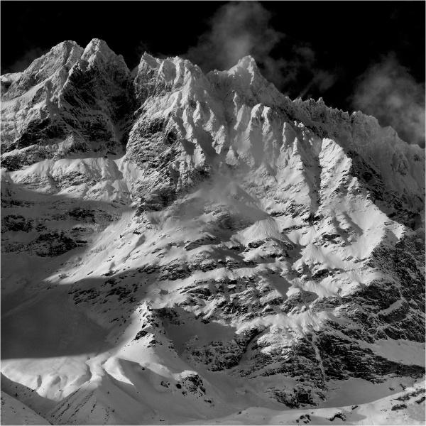 Snowy ridge and mist by fredsphotos