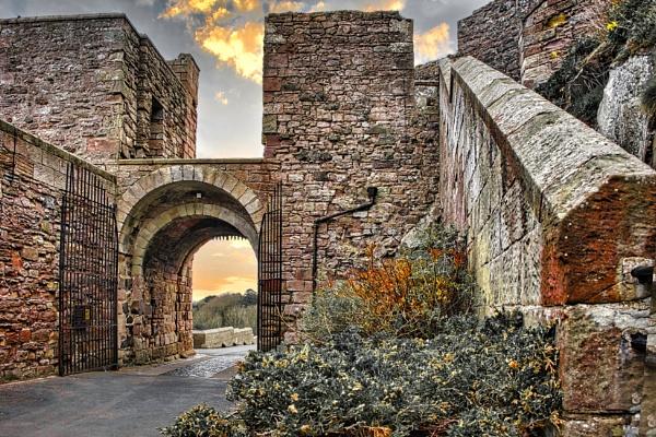 Bamburgh Castle sunset by BiffoClick