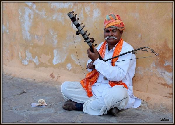 Folk musician. by Manas