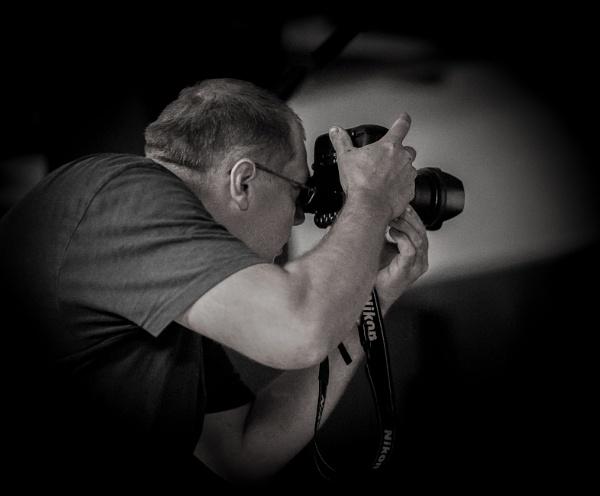 Photographer. by Jukka