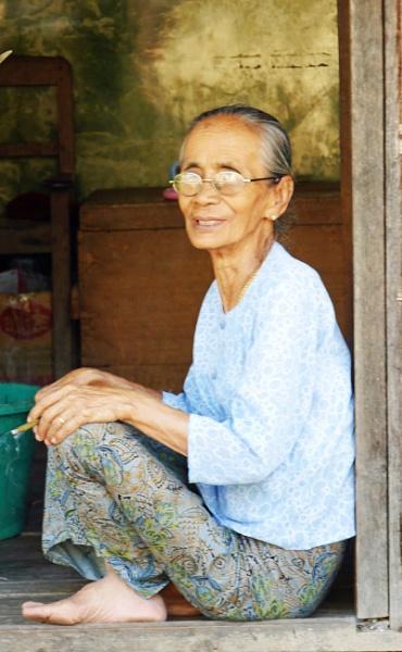 Cheroot-smoking Burmese woman .. by chrisdunham
