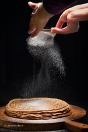 Stack Of Pancakes With Sugar Powder Splashes