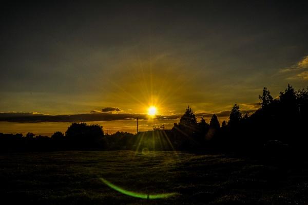 Sunset And Semi Halo by woodini254