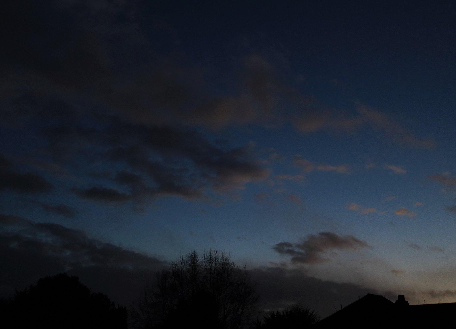 Venus between storm clouds
