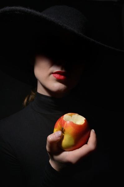 A Woman In A Black Hat holding bitten apple by jordachelr