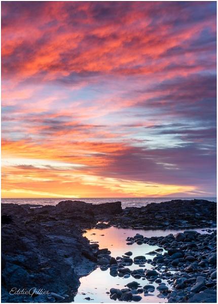 Red sunrise by EddyG