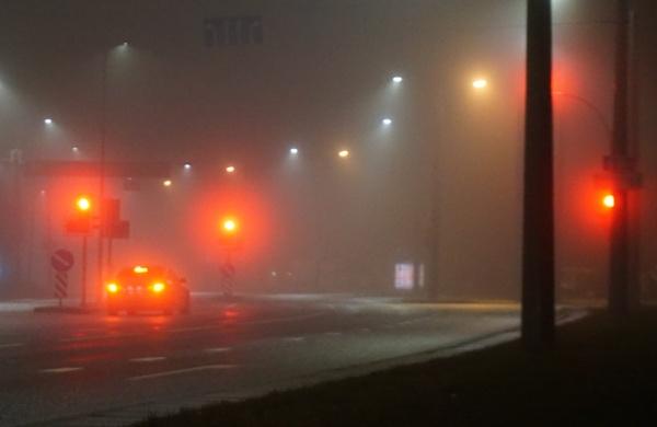 Orange light in the fog by SauliusR