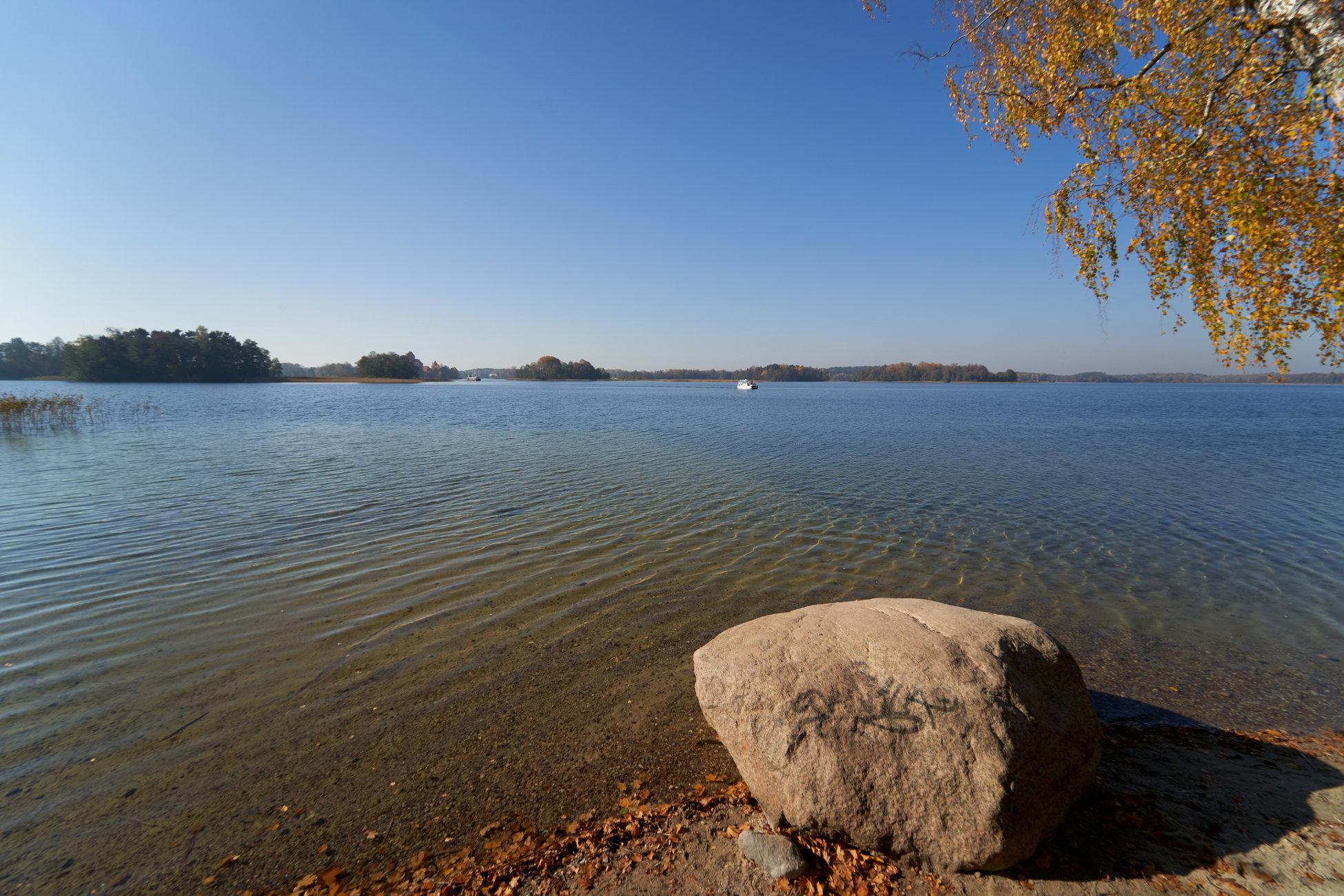Lake Galve near Trakai Island Castle in sunny day. Lithuania.