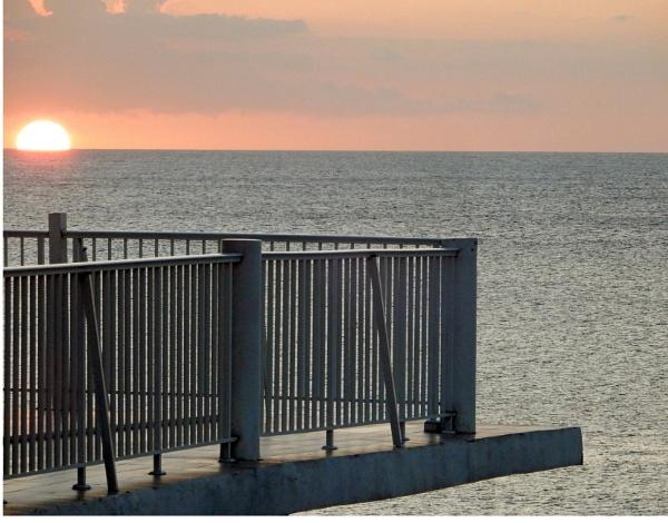 Balcony Sunset by voyger1010