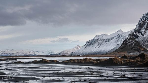 Across the black sand dunes at Vestrahorn by LLCJ