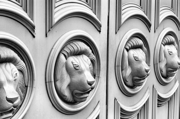 Lions guard the doors by StevenBest
