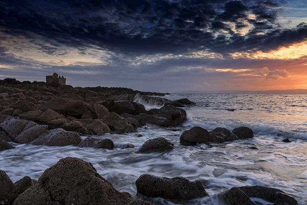 sun goes down on portencross castle by meyeview