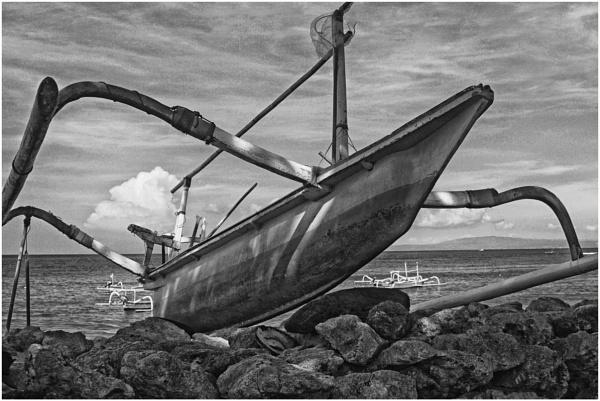 A Fishing Boat On Sanur Beach, Bali, Indonesia by gconant