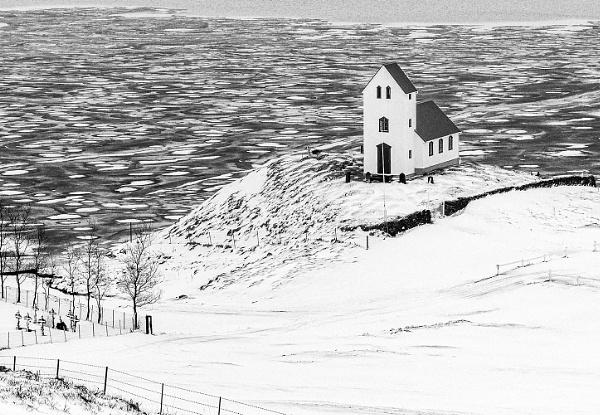 Úlfljótsvatnskirkja Church overlooking frozen waters in Iceland. by pdunstan_Greymoon