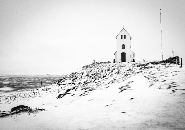 Úlfljótsvatnskirkja Church overlooking frozen waters in Iceland 2. by pdunstan_Greymoon