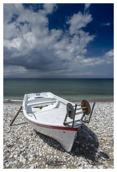 Fishing boat on Filerimos Beach by IainHamer