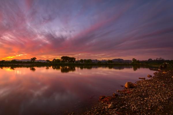 Sunset over River Kaliani by arindomb