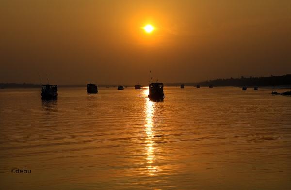 Resting boats at sunset by debu
