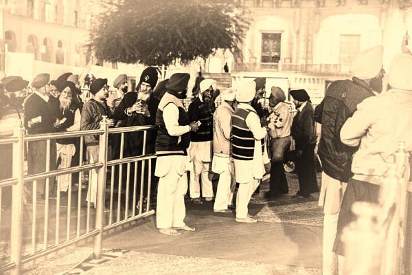 Sikhs waiting to offer prayer by bobbyl