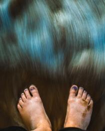 feet in the tide