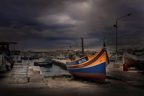 \'\'Water-side Luzzu maintenance\'\'-------- Marsaxlokk Malta by Edcat55
