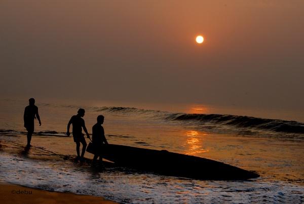 Fishing boat sailing in the sunrise at Puri Sea Beach(India). by debu