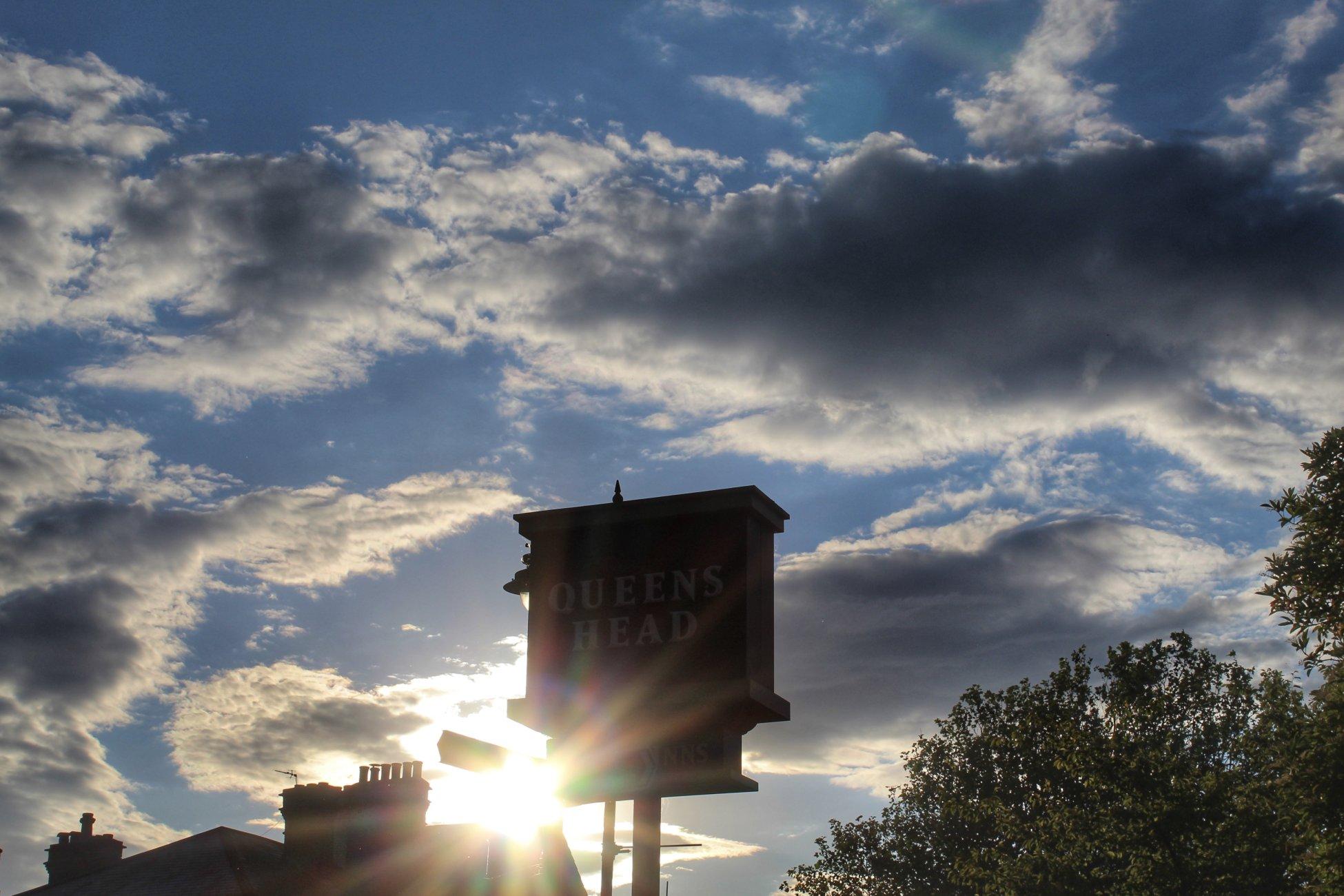 Sunset behind a sign