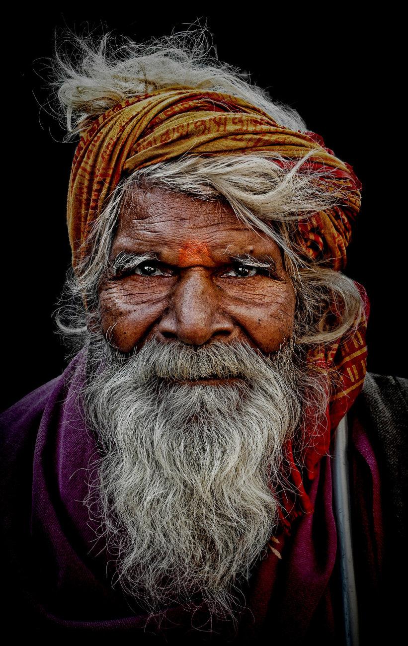 old sadhu on a walking cane