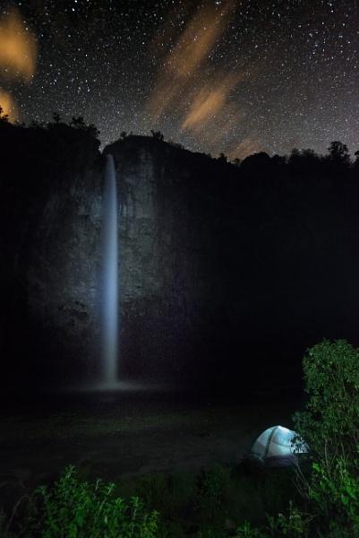 Condor Machay waterfall at night-stars and tent by macxymum