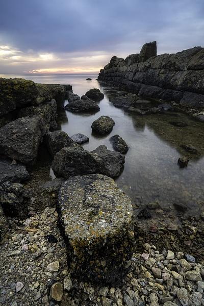 Sunrise between the rocks by happysnapper