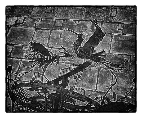 cast iron birds on a stone canvas by bornstupix2