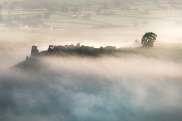 Castle Ruins in Valley mist by thesixer76