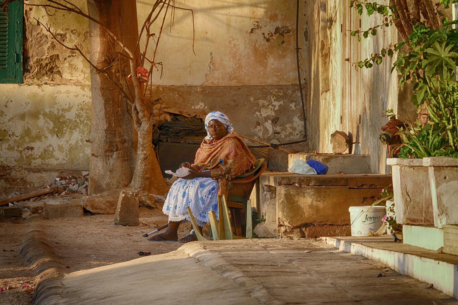 Lady on the street  Isle De Goree