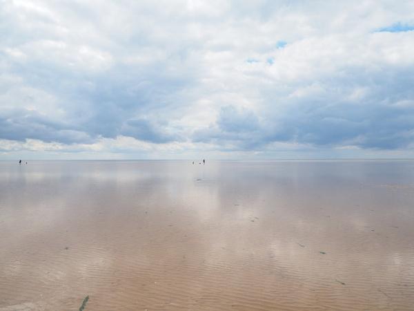 Cloud reflections on beach by GwB