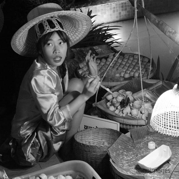 Street Vendor by gpimages