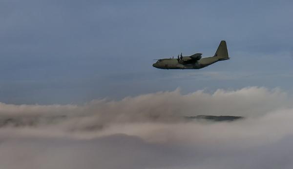 Hercules above a foggy Curbar Edge by photorjp