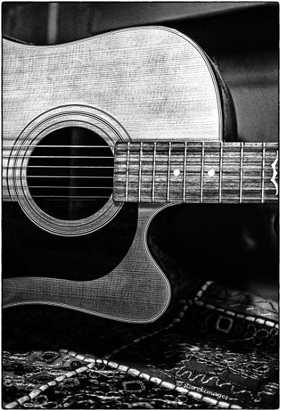 Six Strings, Nine Frets by starckimages