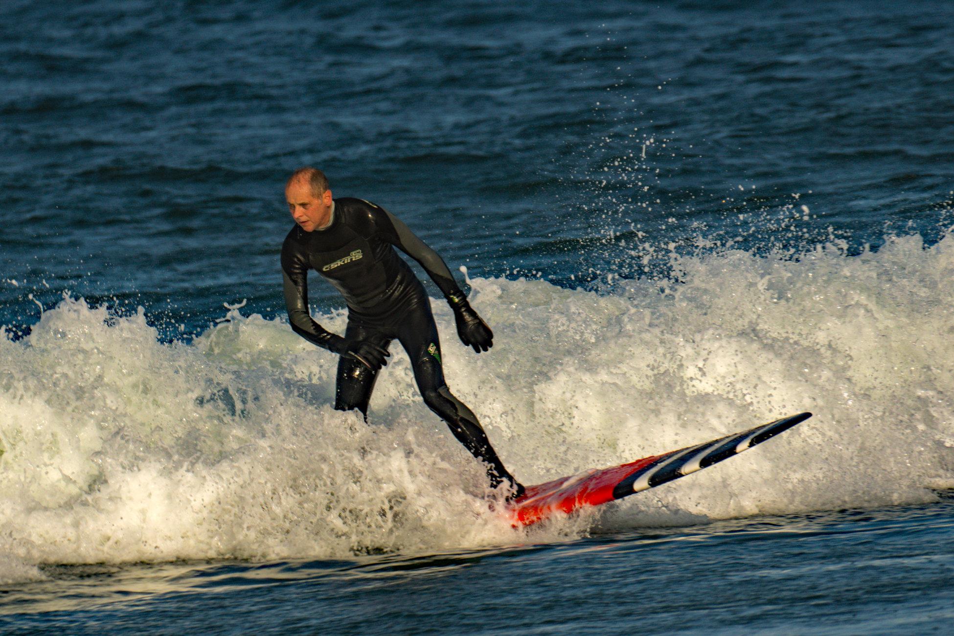Bamburgh Beach Surfer.