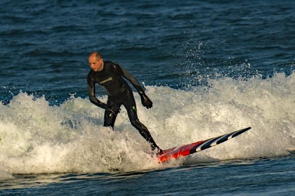 Bamburgh Beach Surfer. by terra