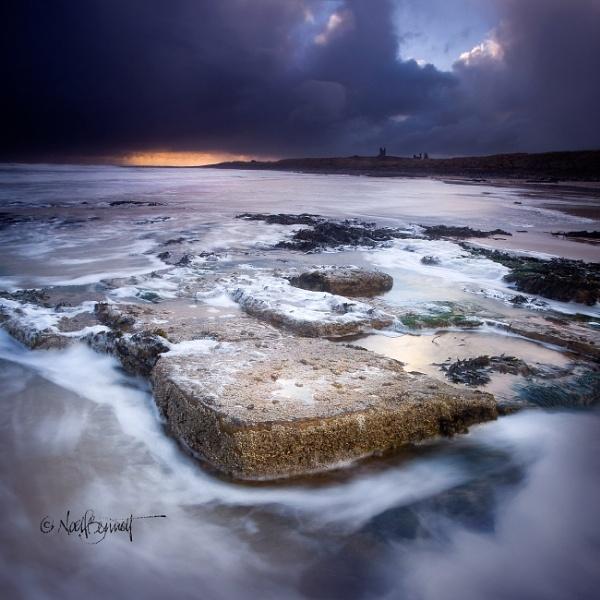 Storm Over Dunstanburgh Castle by NoelBennettPhotography