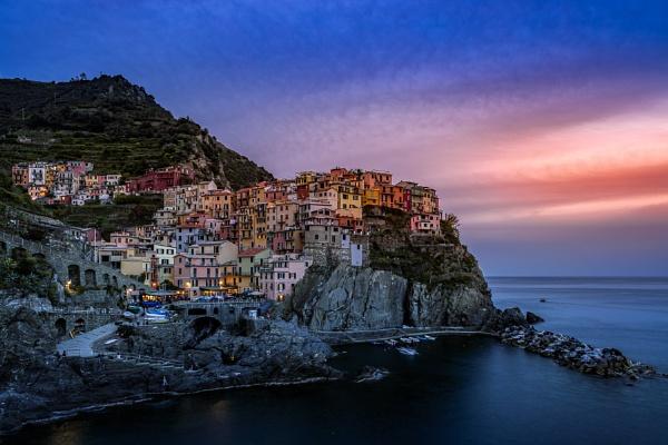 MANAROLA, LIGURIA/ITALY  - APRIL 20 : Coastal view at dusk of Ma by Phil_Bird