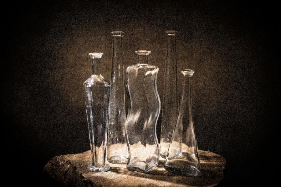 Five clear bottles
