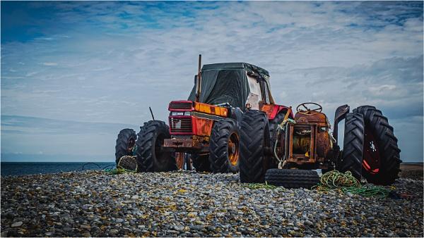 Tractors on Cromer Beach by Dixxipix