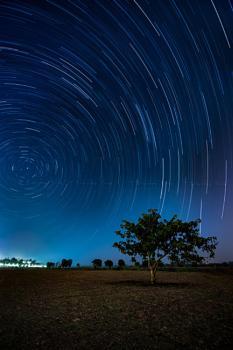Under a starry sky.