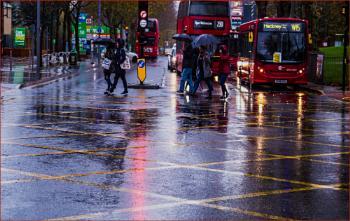 umbrellas crossing...